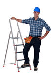 Handyman with step-ladder Royalty Free Stock Images