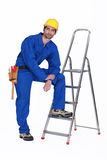 Handyman stood with ladder Royalty Free Stock Images