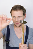 Handyman about to hammer in a nail Royalty Free Stock Image