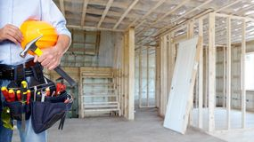 Handyman with a tool belt. House renovation service royalty free stock photography
