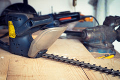 Handyman tool shed with hedge trimmer on the table Royalty Free Stock Photo
