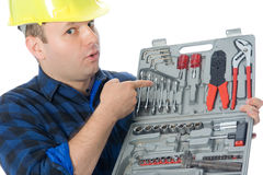 Handyman and toolbox. Worker (handyman) showing with finger on his toolbox representing his satisfaction about tool Stock Image