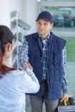 Handyman with toolbox shaking clients hand. Handyman royalty free stock photos