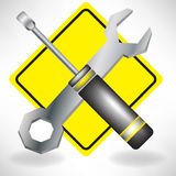 Handyman tools on attention sign Stock Images