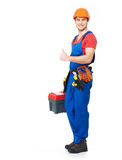 Handyman with tools showing the thumbs up sign Royalty Free Stock Image