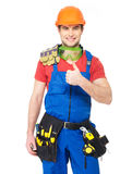 Handyman with tools showing thumbs up sign Royalty Free Stock Photography