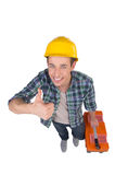 Handyman. Top view of cheerful craftsperson looking at camera and holding his thumb up while isolated on white royalty free stock photos