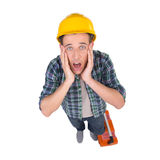 Handyman. Top view of frustrated craftsperson looking at camera and holding head in hands while isolated on white stock image