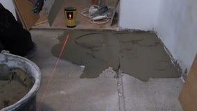 Handyman trowel spread adhesive for ceramic tile stick on floor stock video