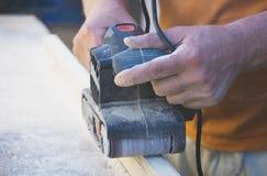 Handyman using electric sander. Royalty Free Stock Images