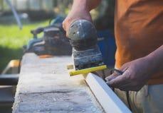 Handyman using electric sander. Royalty Free Stock Photo