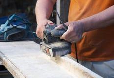 Handyman using electric sander. Stock Images