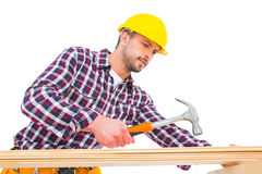 Handyman using hammer on wood Stock Images