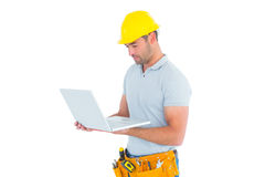 Handyman using laptop Stock Photo