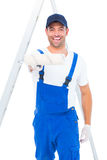 Handyman using paint roller on white background Stock Photos