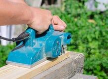 Handyman using polish machine Stock Photo