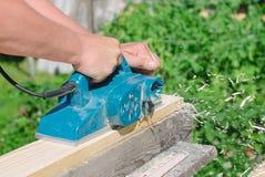 Handyman using polish machine Royalty Free Stock Image