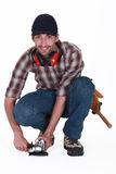 A handyman using a sander Royalty Free Stock Photography