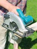 Handyman using saw mashine Stock Photo