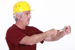 Handyman using screwdriver Stock Photo