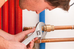 Handyman using wrench Stock Photo