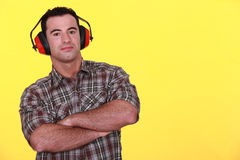 Handyman wearing ear muffs Royalty Free Stock Photography