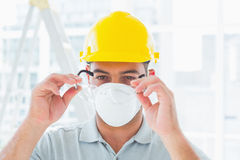 Handyman wearing protective eyewear at site Stock Photos