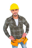 Handyman wearing tool belt with hands on hips Stock Photography