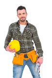 Handyman wearing tool belt while holding helmet and gloves Royalty Free Stock Image