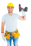 Handyman wearing tool belt while holding power drill Royalty Free Stock Image