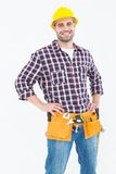 Handyman wearing tool belt while standing hands on hips Royalty Free Stock Images