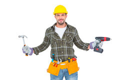 Handyman wearing tool belt. On white background royalty free stock photography