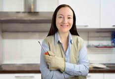 Handyman woman at the kitchen of home royalty free stock photography