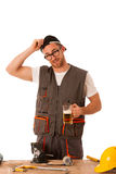 Handyman in work clothing having a break, drinkng beer. Stock Image