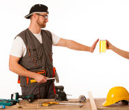 Handyman in work clothing refusing beer, don't drink on workplac. E isolated stock photo