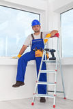 Handyman or worker resting after work Royalty Free Stock Images