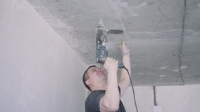 Handyman is working with a drill. Job stock footage