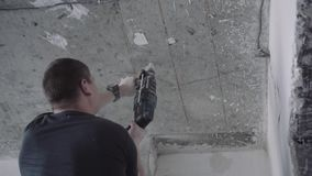 Handyman is working with a drill. Job stock video