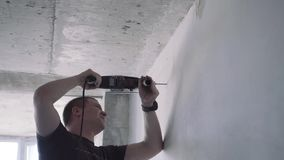 Handyman is working with a drill. Job stock video footage