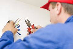 Handyman working with wires Stock Photography