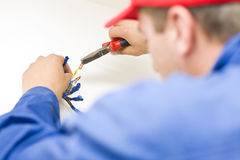 Handyman working with wires Stock Photos