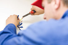 Handyman working with wires Royalty Free Stock Photo