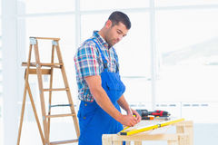 Handyman working at workbench in office Royalty Free Stock Images