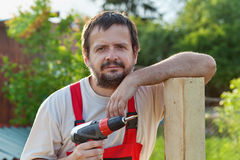 Handyman working in the yard Stock Photo