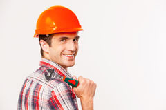 Handyman with wrench. Royalty Free Stock Image