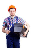 Handyman with wrench and toolbox Royalty Free Stock Photo