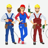Handymen and handywoman with drills Stock Photography