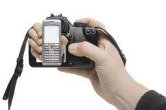 Handyshot. A hand reaches out of a digital camera Royalty Free Stock Images