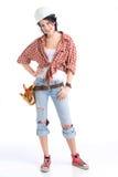 Handywoman. Beautiful young craftsperson wearing a tool belt an an hardhat Stock Image