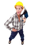 Handywoman with drill Stock Photo